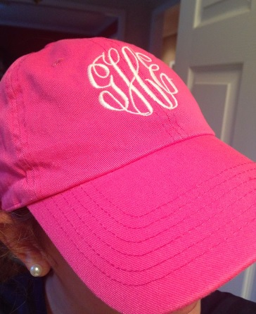 neon pink monogram hat with pearl studs